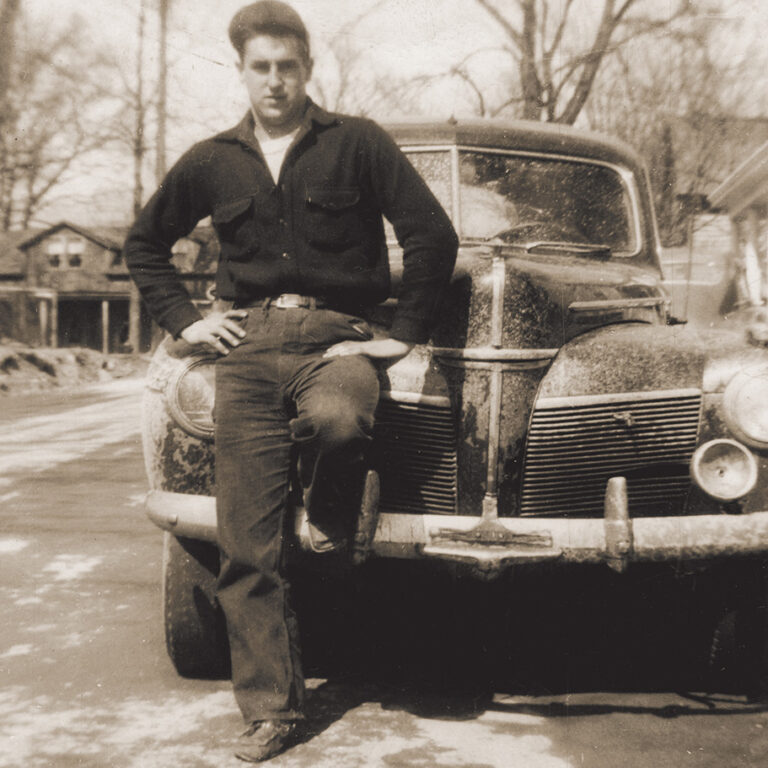 joseph carr standing by car